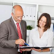secretary presenting file - stock photo