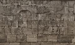 Medieval carving on the walls of the borobudur temple Stock Photos