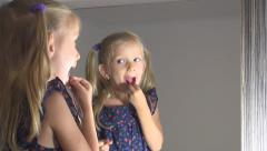 Little Girl Makeup Herself, Child Playing in Mirror, Children Imitating Adults - stock footage