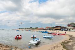 tourist watersport beach on bali - stock photo