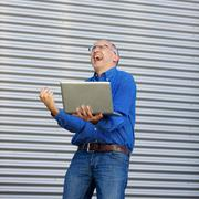Excitement businessman outddor Stock Photos