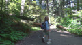 POV of Child Hiking in Mountains, Tourist Girl Walking, Climbing Path in Forest HD Footage