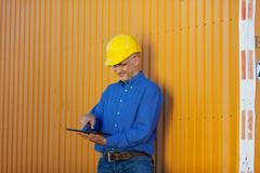 Male architect working with digital tablet Stock Photos