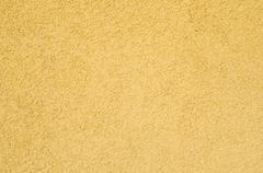Rough yellow plaster texture Stock Photos