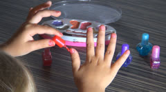 Little Girl Painting her Nails with Polish Nails, Kid Playing With Polish Nails Stock Footage