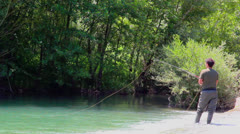 Fisherman casting during Fly fishing Stock Footage