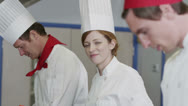 Stock Video Footage of Portrait of a happy female chef in a commercial kitchen