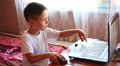 little boy playing in a laptop 3 Footage