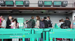 People waiting to check-in at airport - stock footage