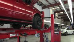 Stock Video Footage of Pan past truck on alignment rack at auto body shop