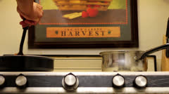 Man cooking ground beef on a stove Stock Footage