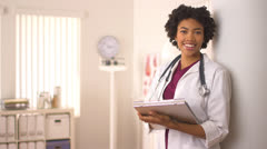 Female African American doctor holding medical chart Stock Footage