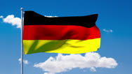 Stock Video Footage of German flag waving over a blue cloudy sky