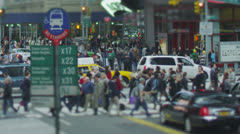 New York City central with crowds of people and passing traffic Stock Footage