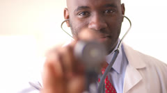 Rack focus between stethoscope and black doctor - stock footage