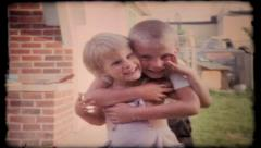 234 - brother hugs sister in intimate moment - vintage film home movie - stock footage