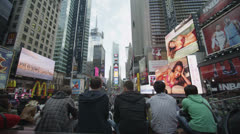 Crowds of tourists gather at Times Square in New York City Stock Footage