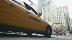Yellow taxi waiting in traffic in New York City - stock footage