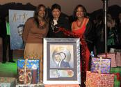 Stock Photo of natalie cole, sisters timolin and casey.natalie cole lights capitol's legend