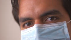 Hispanic doctor in surgical mask Stock Footage