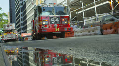 Fire crews respond to an emergency call in a district of Manhattan Stock Footage