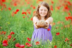 Stock Photo of little girl with bread