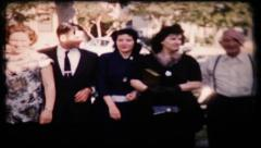 239 - family gathers for funeral - vintage film home movie - stock footage