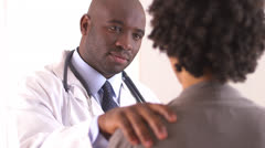 Black doctor talking to patient Stock Footage