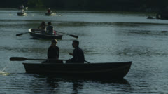People in rowboats on central park lake New York - stock footage