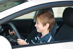 driving little boy - stock photo