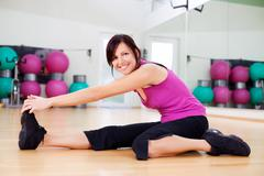 athletic woman working out in a gym - stock photo