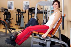 Young attractive brunette woman in the gym Stock Photos