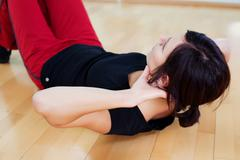 Woman sit ups Stock Photos