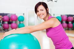 Smiling fit woman Stock Photos