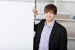 businessman with hand on flip chart - stock photo