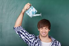 Male student holding watering can Stock Photos