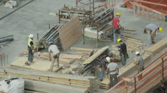 Construction workers on a rooftop building site Stock Footage