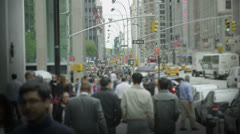 Bustling New York City scene with crowds of people walking and traffic passing - stock footage