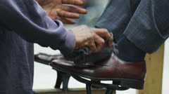 Businessman gets a New York City shoe shine Stock Footage