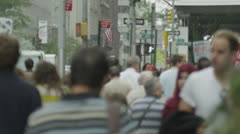 Bustling New York City central scene with crowds of people walking - stock footage