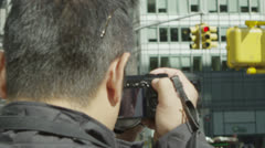 Anonymous male tourist taking photographs on a New York City street Stock Footage