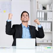 successful businessman rejoicing - stock photo
