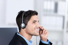 customer service executive conversing on headset - stock photo