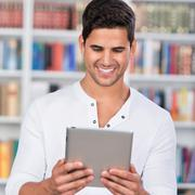 Student holding digital tablet in library Stock Photos