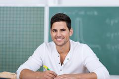 Young male student in classroom Stock Photos