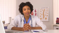 African American woman doctor listening - stock footage