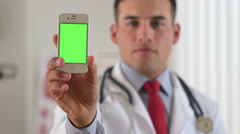 Hispanic doctor showing green screen of smartphone Stock Footage