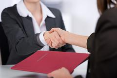 Candidate shaking hands with businesswoman Stock Photos