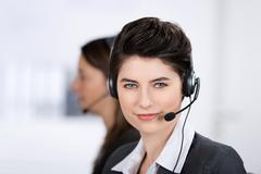Customer service executive wearing headset Stock Photos