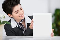 receptionist showing a blank tablet - stock photo